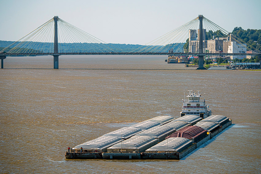barge-on-the-mississippi-river-moving-towards-bridge.jpg