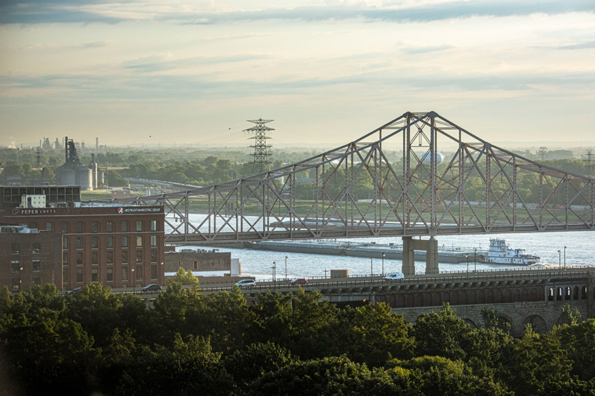 barge-traveling-under-bridge-on-mississipi-st-louis.jpg