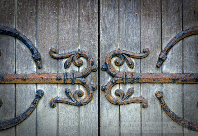 old-wooden-door-with-ornamental-metal-photo.jpg