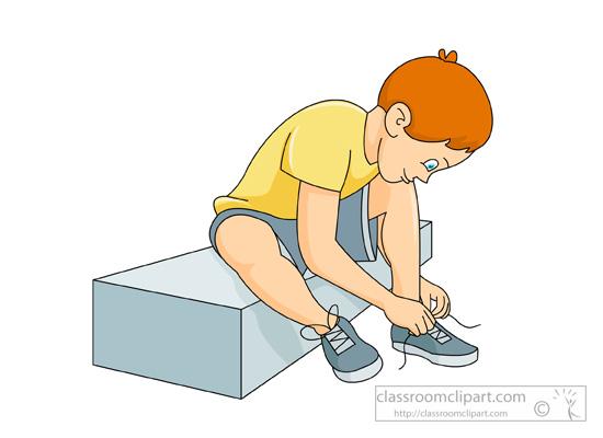 boy-sitting-down-tying-shoelace.jpg