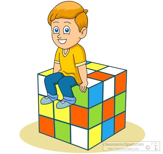 cartoon-style-boy-sitting-atop-large-rubric-cube.jpg