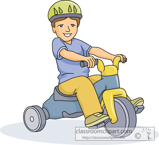 young_boy_wearing_a_helmet_on_tricycle.jpg