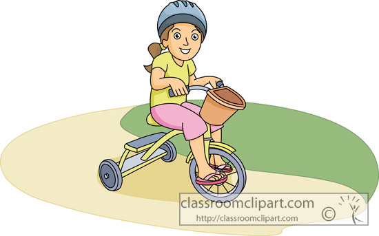 young_girl_wearing_a_helmet_on_tricycle.jpg