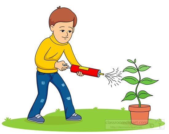 boy-spraying-pesticides-on-plant.jpg