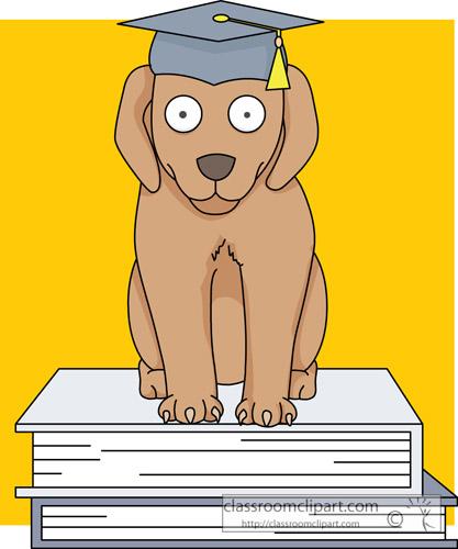 dog_with_graduation_cap_on_books.jpg