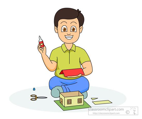 boy-making-house-using-glue-scissors.jpg