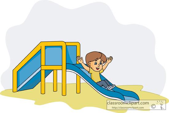 boy_going_down_playground_slide.jpg