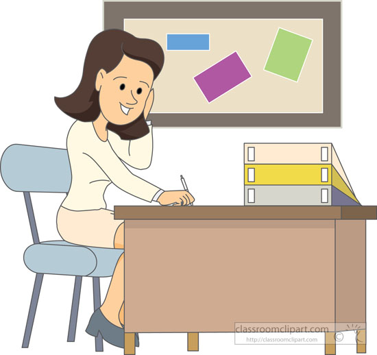 School Teacher Sitting At Desk Grading Papers