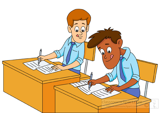 Two Students Sitting At Desk Taking An Exam