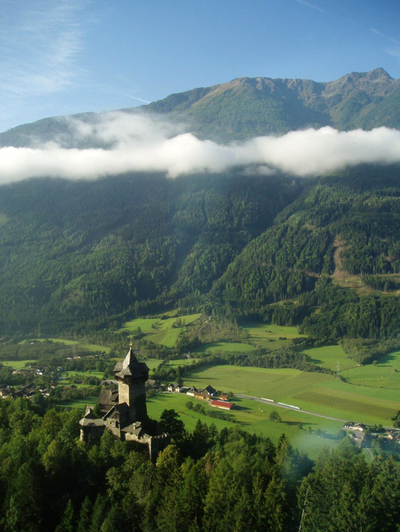 castle-and-mountain-valley-in-the-Alps A.jpg