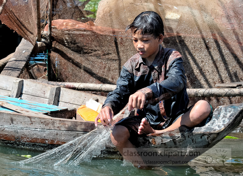 Photo-Child-Fishing-in-Water-Floating-Village-of-Chong-Khneas-15.jpg