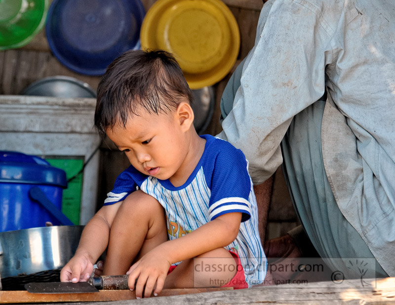 Photo-Child-in-Houseboat-Floating-Village-of-Chong-Khneas-17.jpg