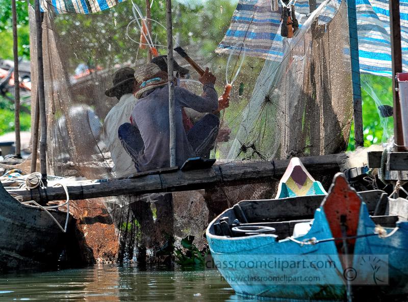 Photo-Fisherman-Floating-Village-of-Chong-Khneas-07.jpg