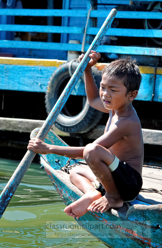 Photo-Young-boy-in-Boat-near-Floating-Village-of-Chong-Khneas-16.jpg