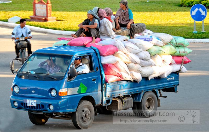 flat-bed-truck-transportation-people-and-grain-phnom-penh-58.jpg