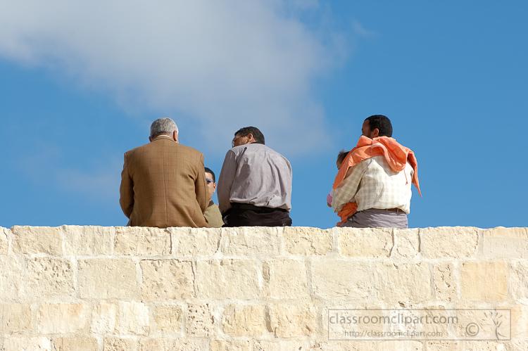 men-sitting-on-wall-qaitbay-citadel-5251.jpg