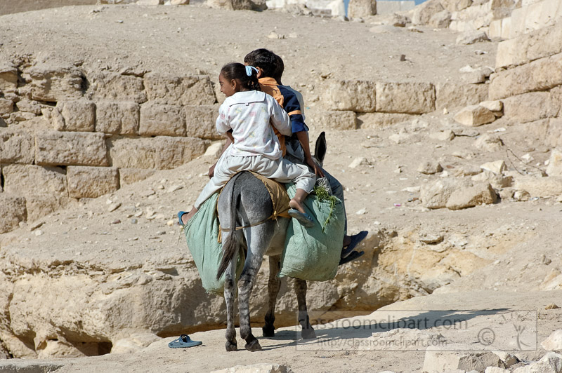 riding-donkey-near-pyramids-giza-egypt-photo_5407.jpg