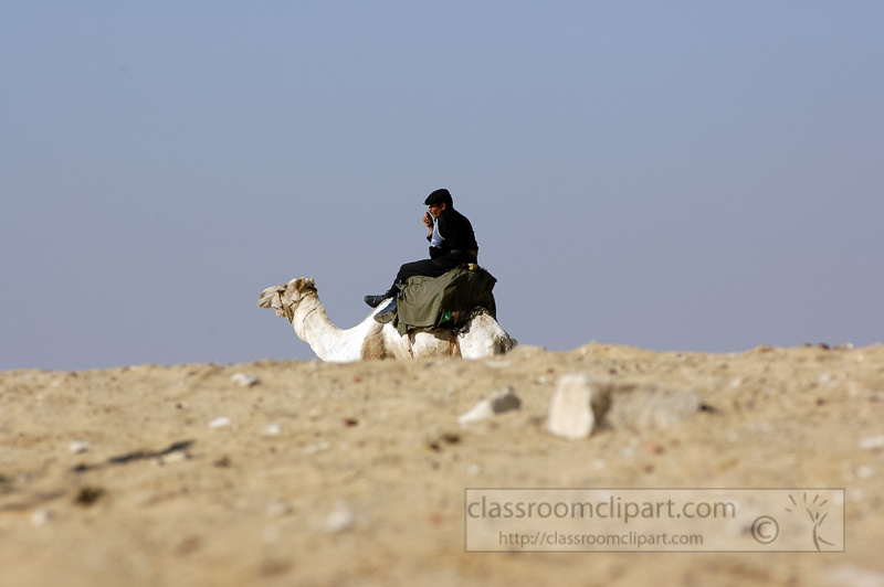 egyptain-guard-sitting-on-camel-photo-image-4937b.jpg
