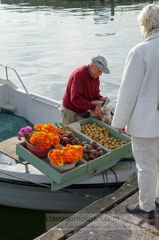 man-selling-vegetables-from-his-boat-finland-2518.jpg