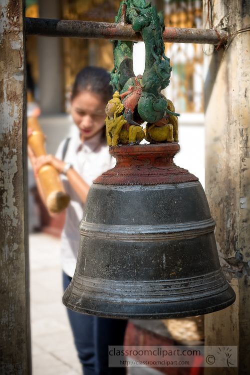 Vistor-with-bamboo-stick-hitting-bell-at-Shwedagon-Pagoda-in-Yangon-Myanmar.jpg