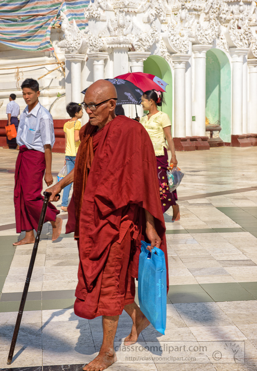 buddhist-monk-in-traditional-robes-walking-6572E.jpg