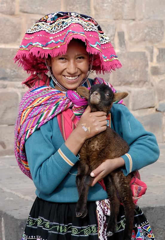Girl-in-traditional-dress-holding-baby-Alpaca-Cuzco-Peru_011.jpg