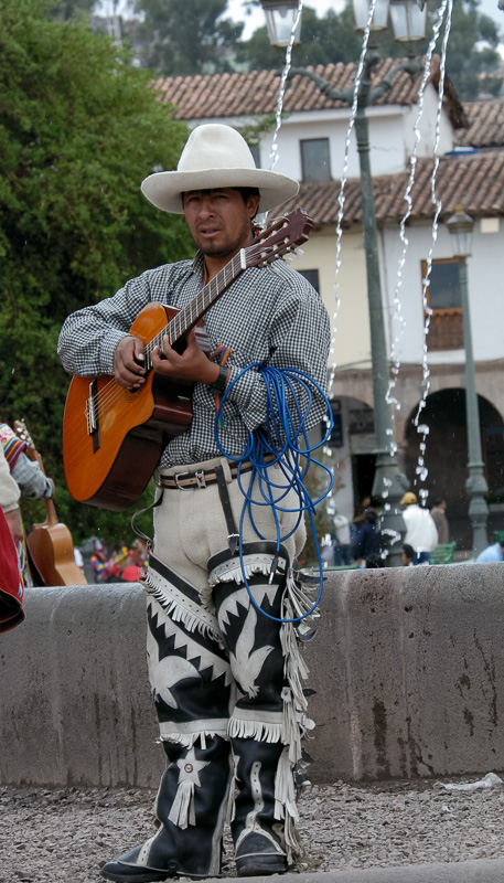 Man-with-guitar-wearing-traditional-costumes-Cuzco-Peru-001.jpg