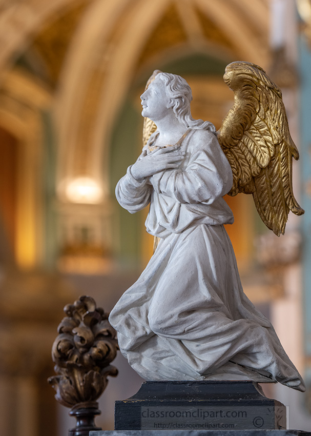 closeup-view-of-an-angel-with-folded-hands-over-heart.jpg