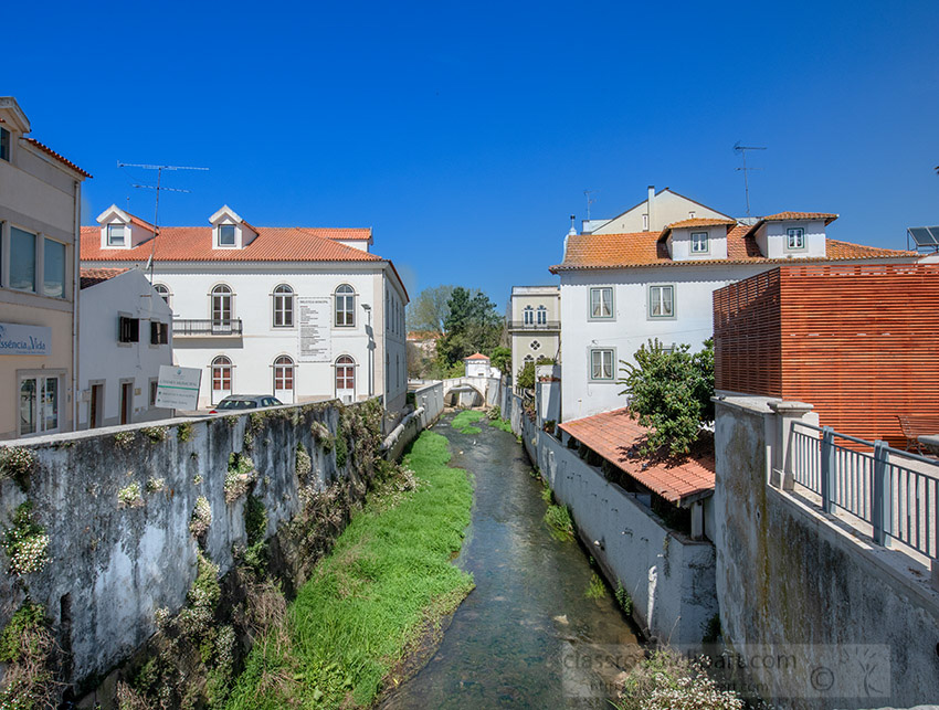 houses-along-dried-river-alcobaca-portugal.jpg