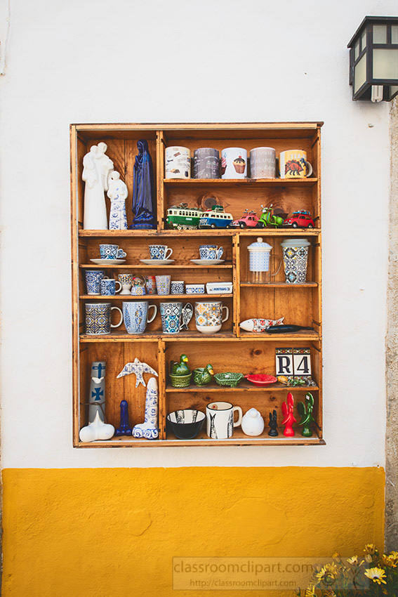 items-for-sale-white-washed-building-obidos-portugal.jpg