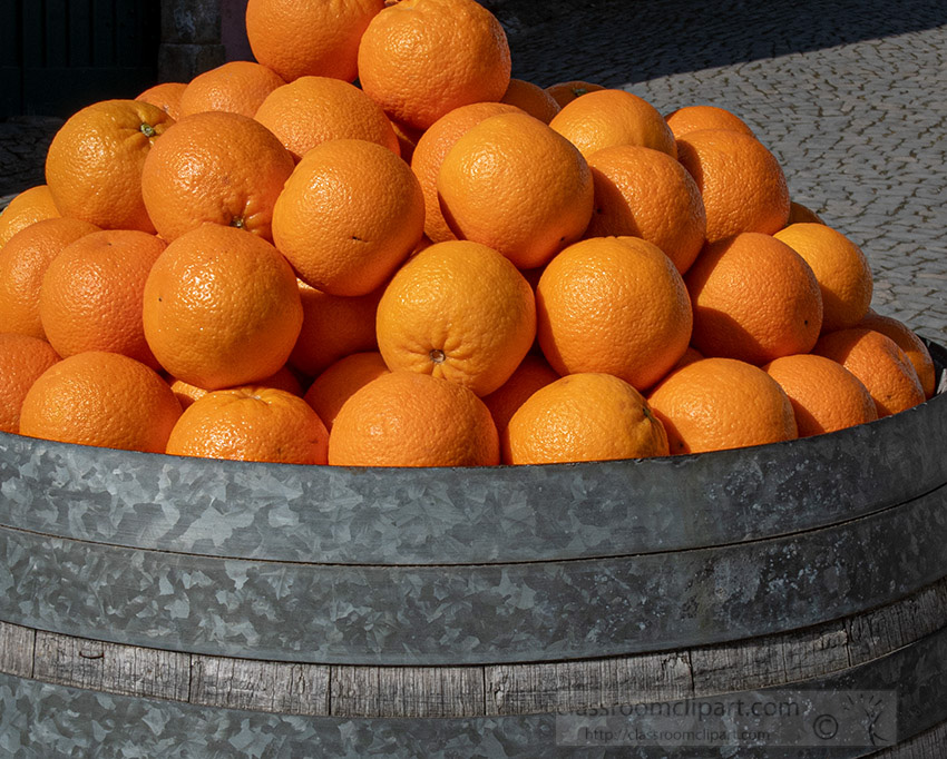 metal-conainer-full-of-ripe-oranges.jpg