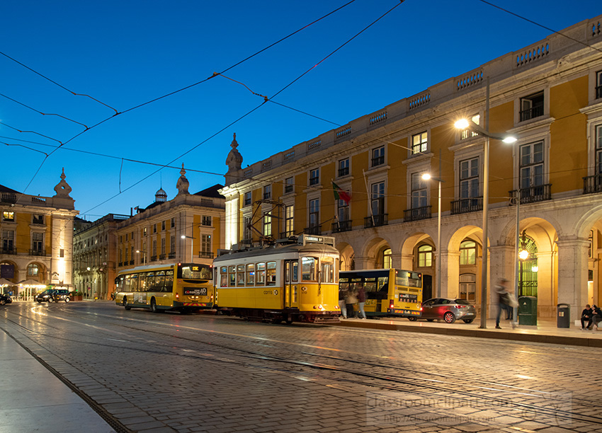 trams-on-a-street-in-lisbon-by-night.jpg