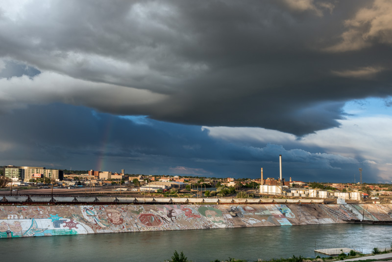 roiling-clouds-and-a-rainbow-appear-above-the-skyline-of-pueblo-colorado.jpg