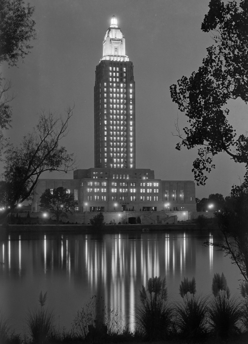 louisiana-state-capitol-baton-rouge-louisiana-tower-lights-at-night-reflected-in-lake-photo.jpg