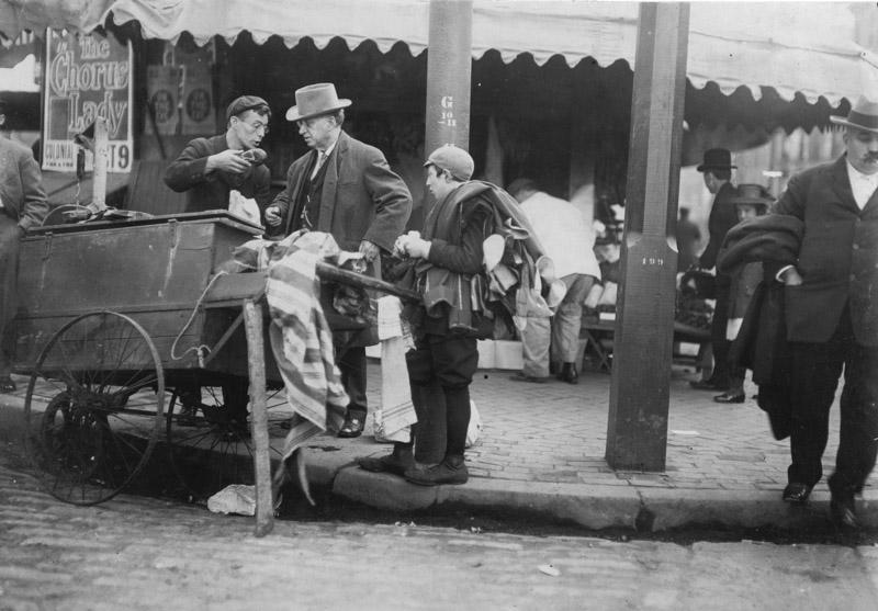 typical-errand-boy-minding-another-boy-business-1909.jpg