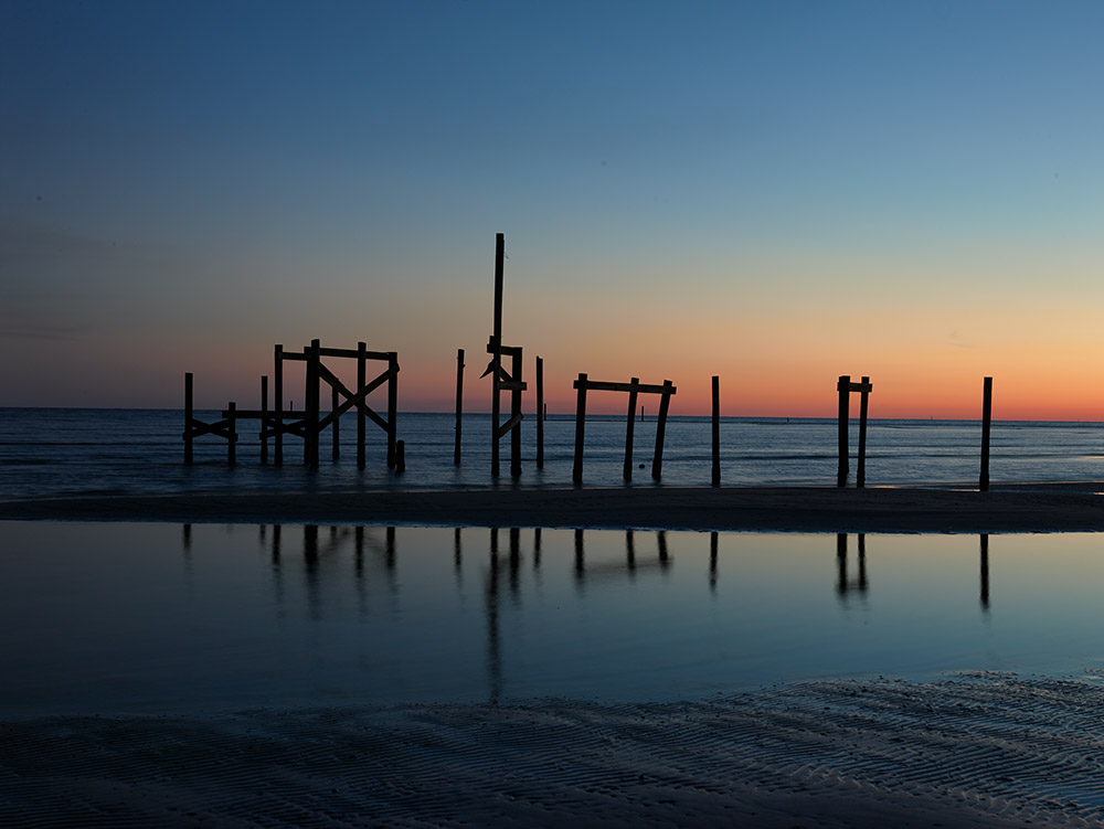 remnants-of-an-old-fishing-pier-at-dusk-along-the-gulf-of-mexico-off-bay-st-louis-mississippi.jpg