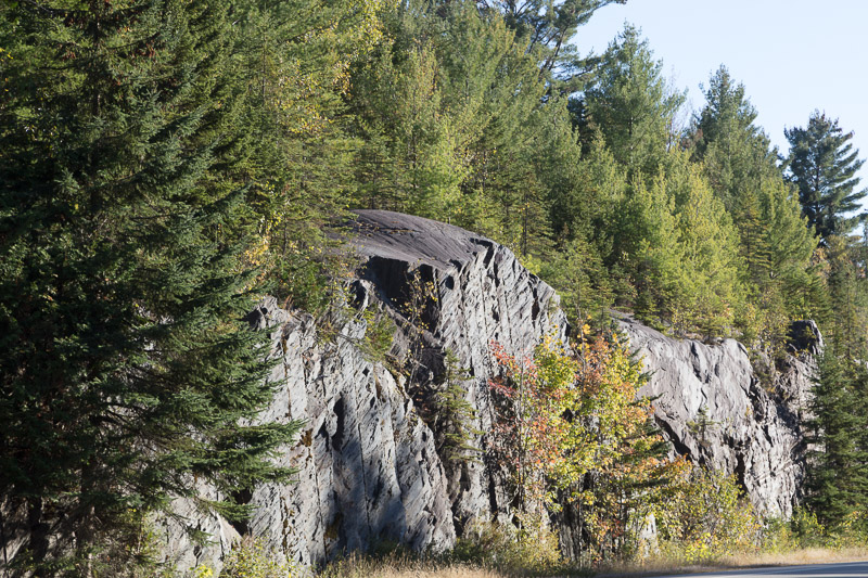 photo-rock-cut-covered-by-evergreens-on-highway-in-new-hampshire.jpg