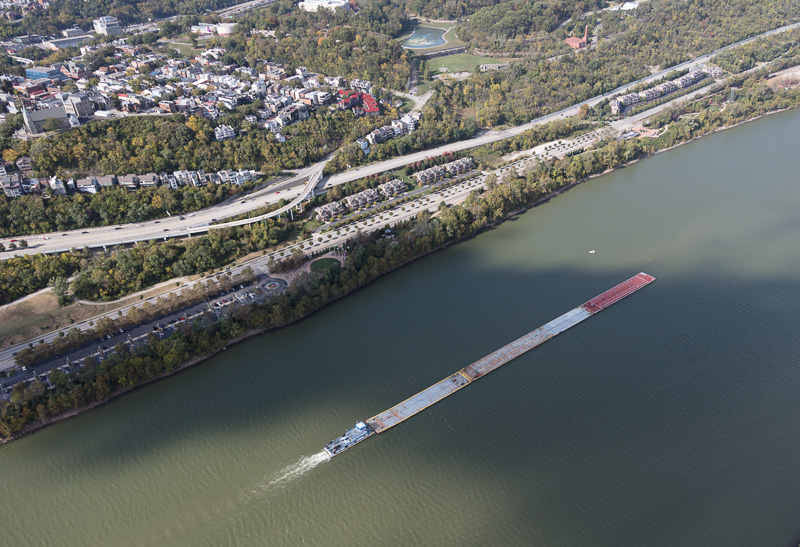 aerial-view-of-a-tugboat-pushing-barges-upstream-on-the-ohio-river.jpg