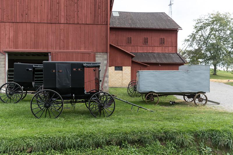 barns-and-horse-drawn-buggies-and-farm-wagons-at-yoders-amish-home.jpg