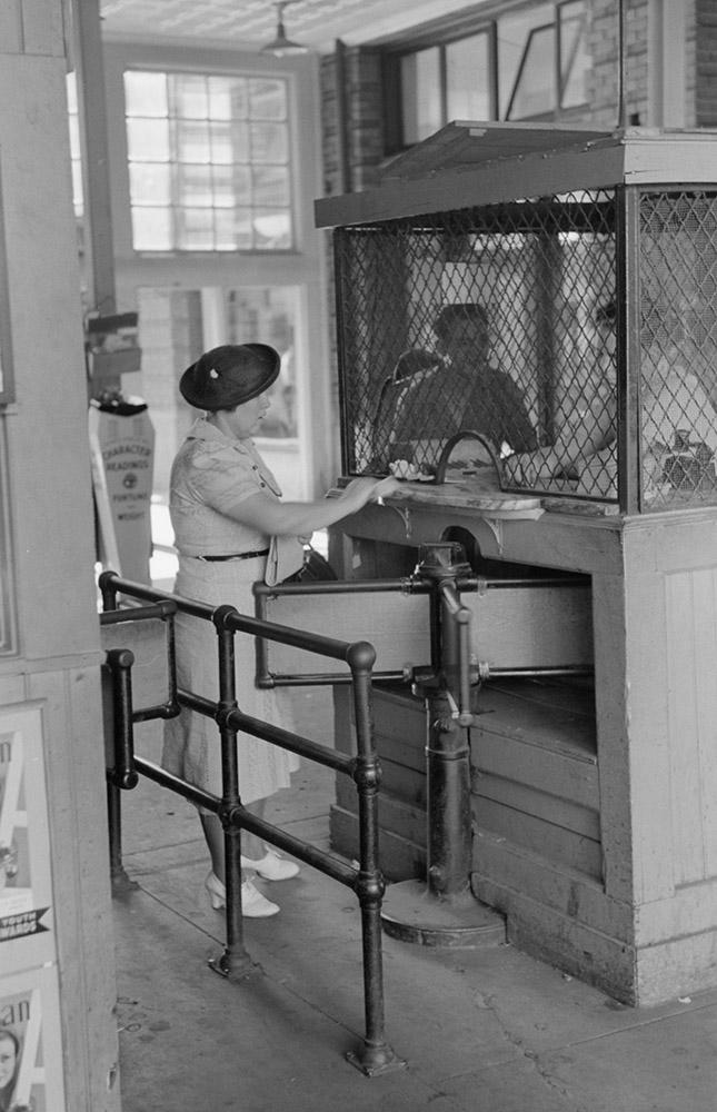 woman-buying-ticket-at-gate.-streetcar-terminal-oklahoma-city-oklahoma.jpg