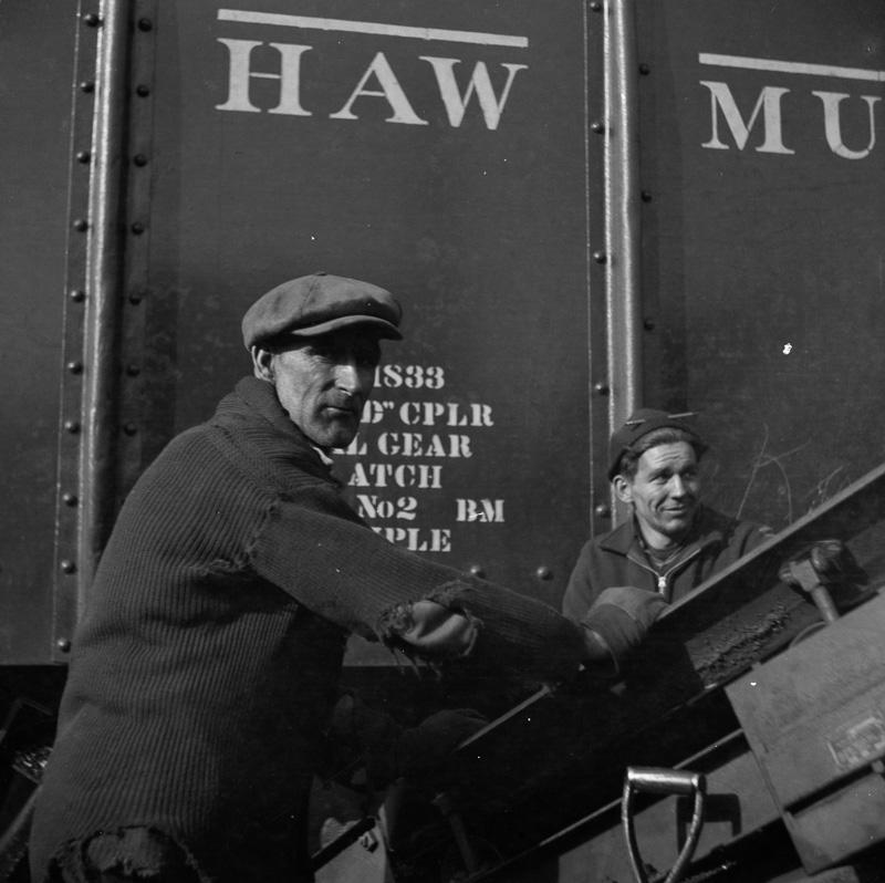 workmen-in-a-coal-yard-near-the-south-street-bridge.jpg