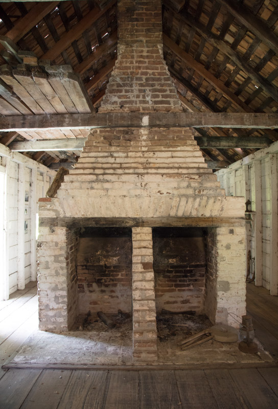 photo-double-fireplace-inside-the-slave-quarters-at-hopsewee-plantation-in-south-carolina.jpg