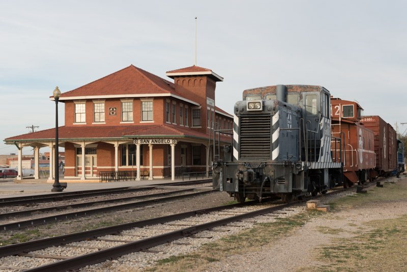 photo-freight-engine-and-cars-parked-beside-the-old-santa-fe-railroad-station.jpg
