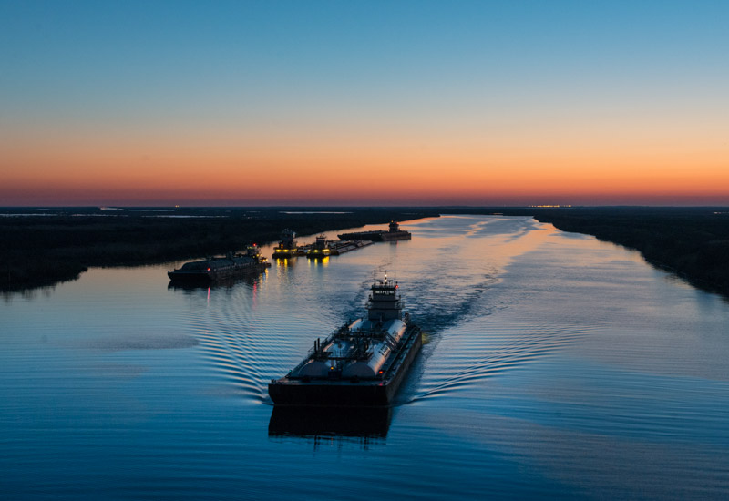 photo-of-barges-traversing-a-short-canal.jpg