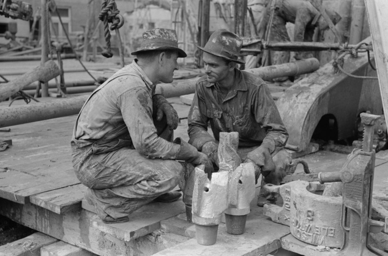 photo-oil-field-workers-talking-together-with-bits-in-front-of-them-kilgore-texas-1939.jpg