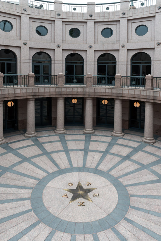 photo-reverse-of-the-texas-state-seal-appears-in-terrazzo-in-the-atrium-within-the-underground-texas-capitol-extension.jpg