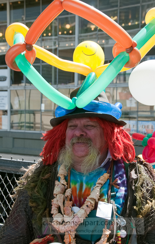 man-dressed-as-clown-with-balloons-on-his-head-photo-image-611.jpg
