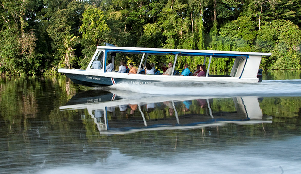 tourist-boat-along-river-in-costa-rica-jungle.jpg