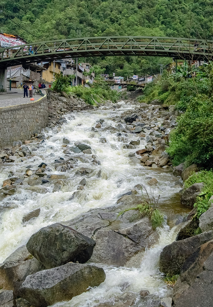 fast-moving-river-flowing-under-bridge-in-peru.jpg
