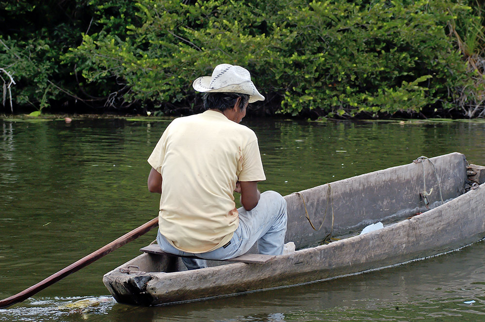 old-wooden-boat-used-to-fish-on-river-in-belize.jpg